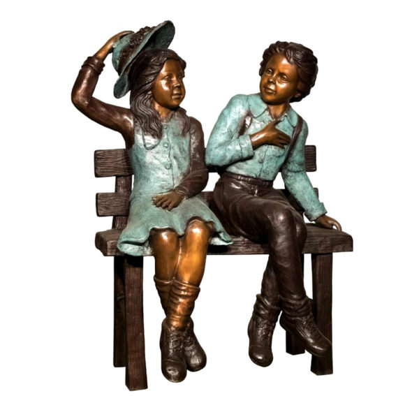 Bronze statue boy and girl sat on the bench