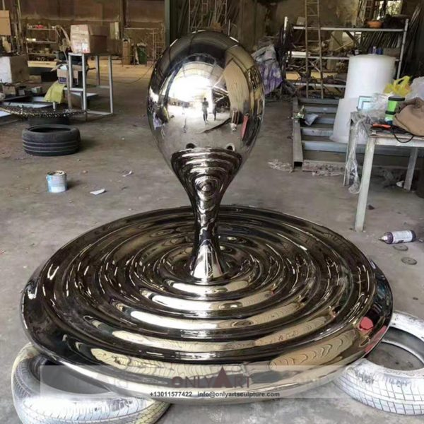 Large stainless steel mirror water drop sculpture in outdoor square